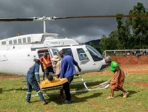 A wounded survivor is evacuated after Cyclone Idai