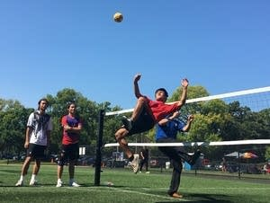 A sepak takraw player mid-air during a spike