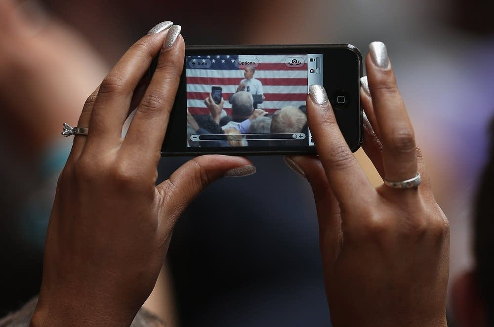 An Obama supporter snaps a picture