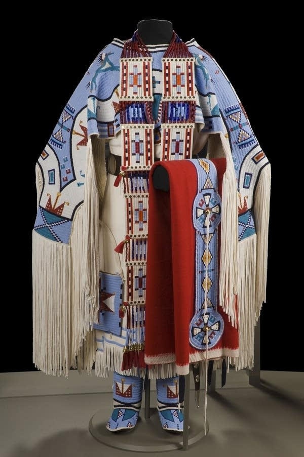 """Give Away Horses,"" an intricately beaded Dakota dress and accessories."