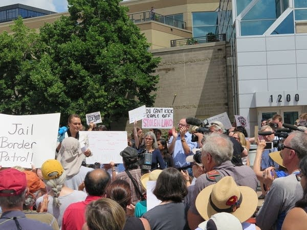 Protesters gather outside of Sen. Amy Klobuchar's office