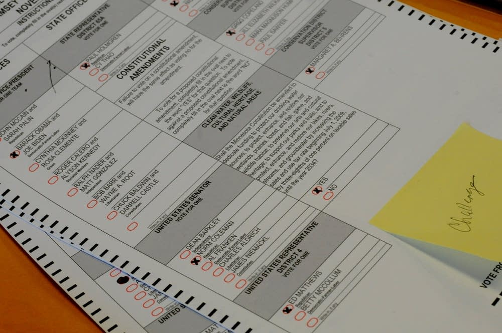 A stack of challenged ballots