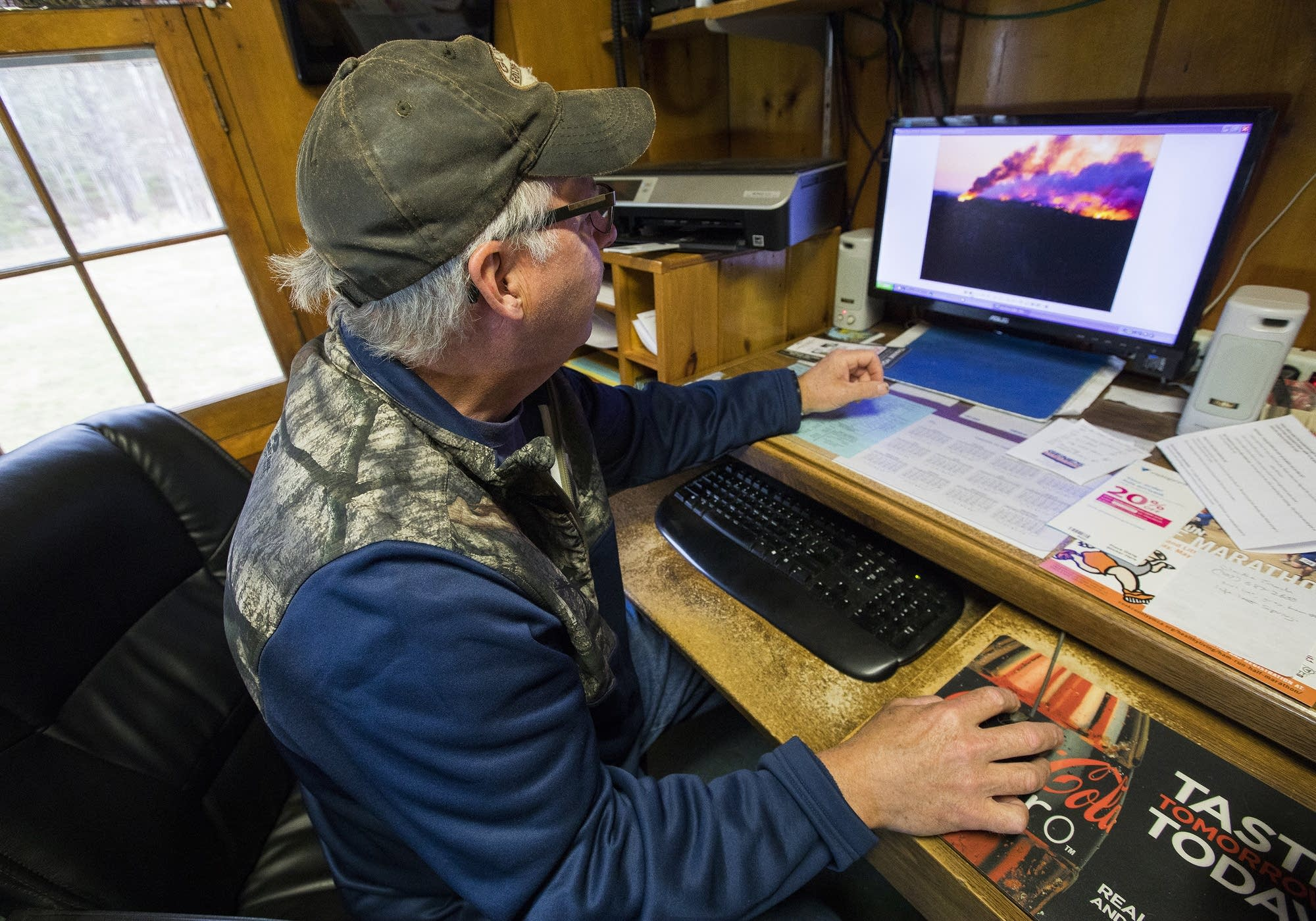Dan Baumann looks through photos he took during the fire.