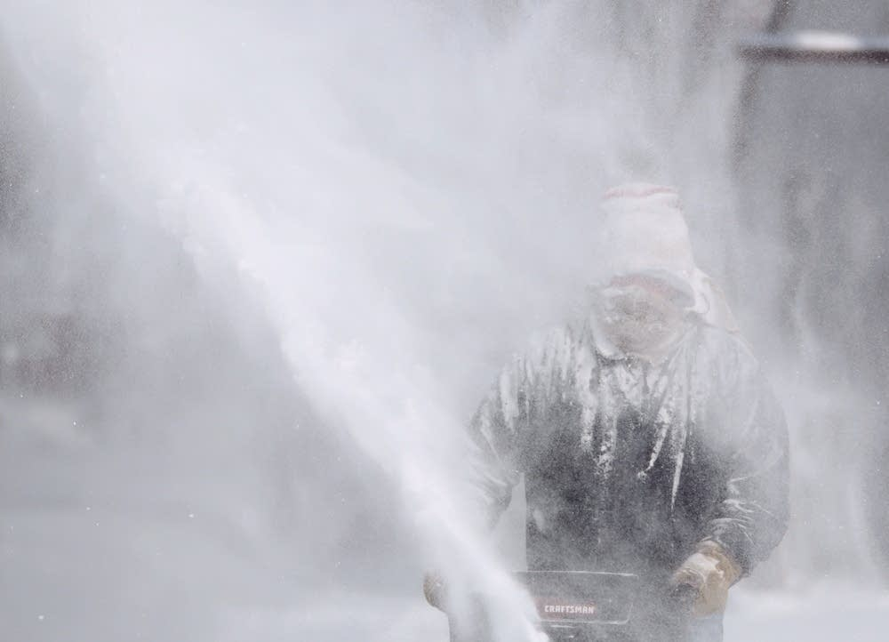 Jim Koran blows snow at his home in St. Paul.