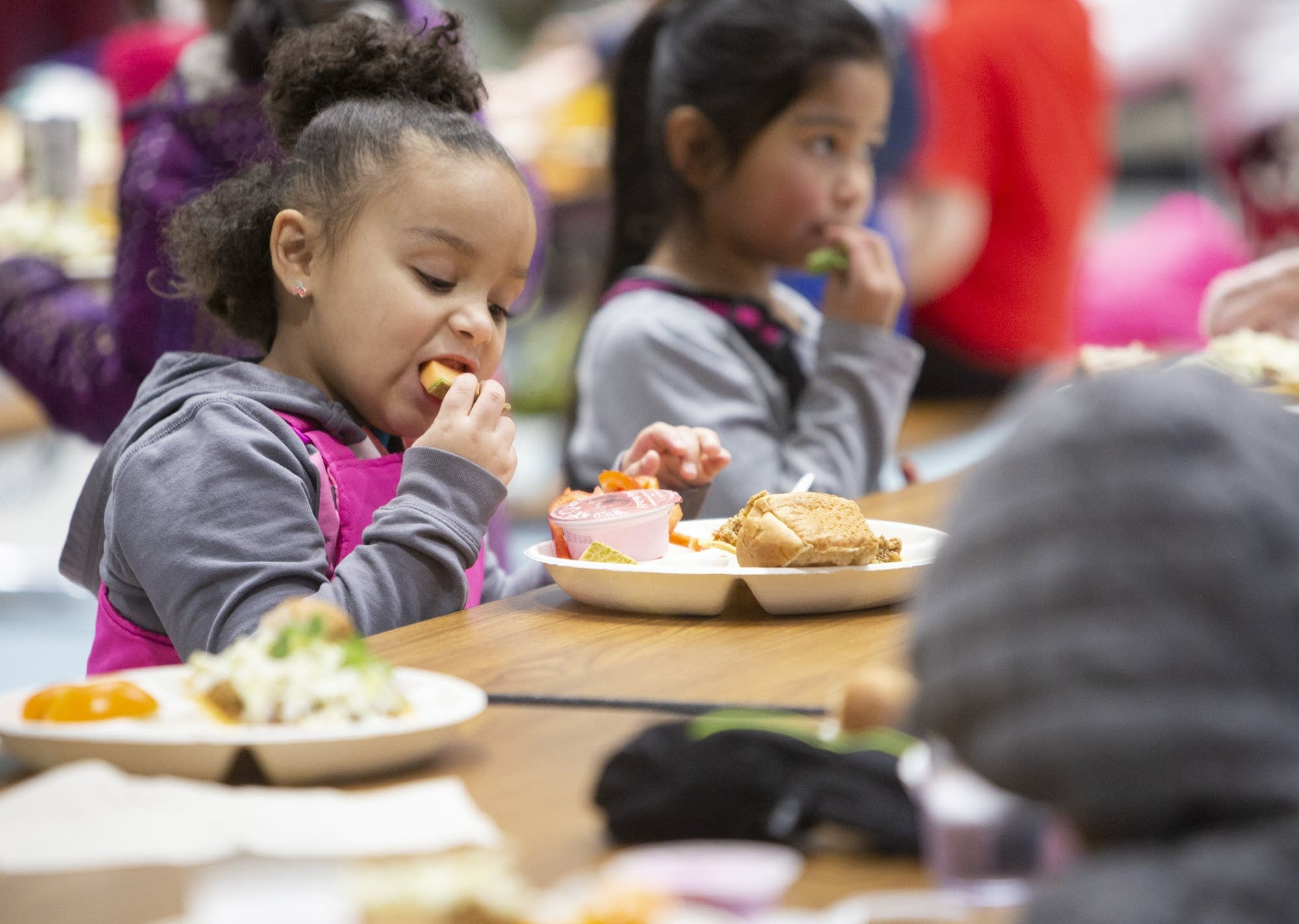 Kindergartner Tamryn eats cantaloupe during lunch.