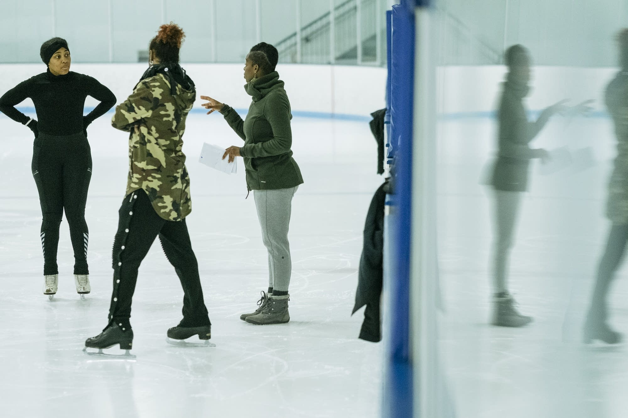 Brownbody skaters talk during rehearsal.