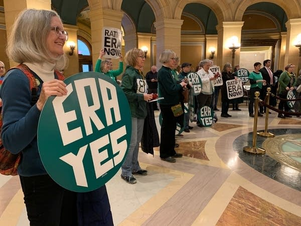 One woman holds an ERA Yes sign, with many more in the background.