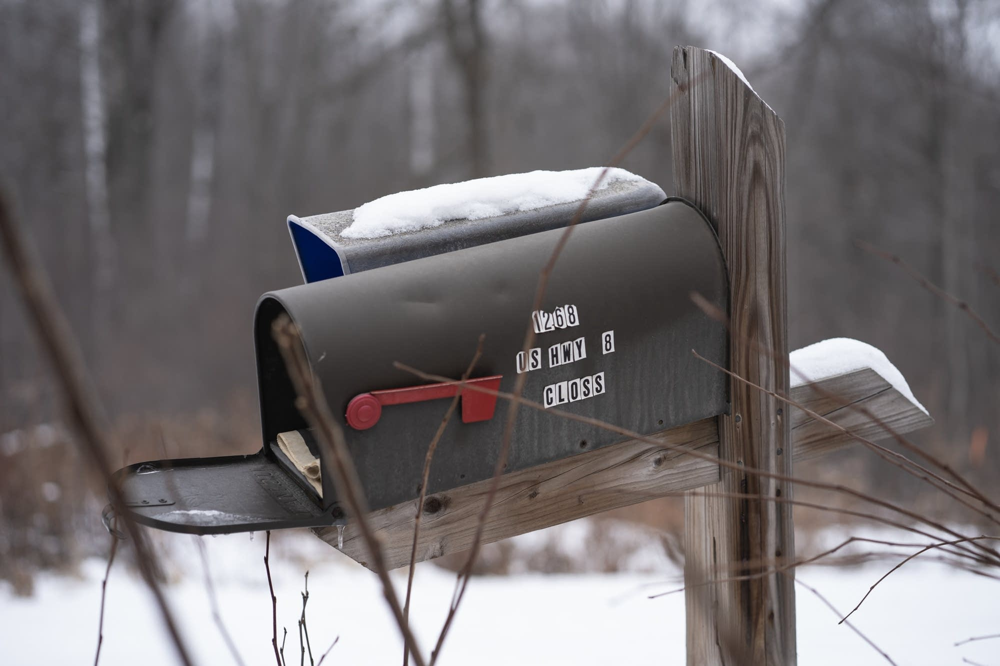 The mailbox sits open outside of the Closs home in Barron, Wis.