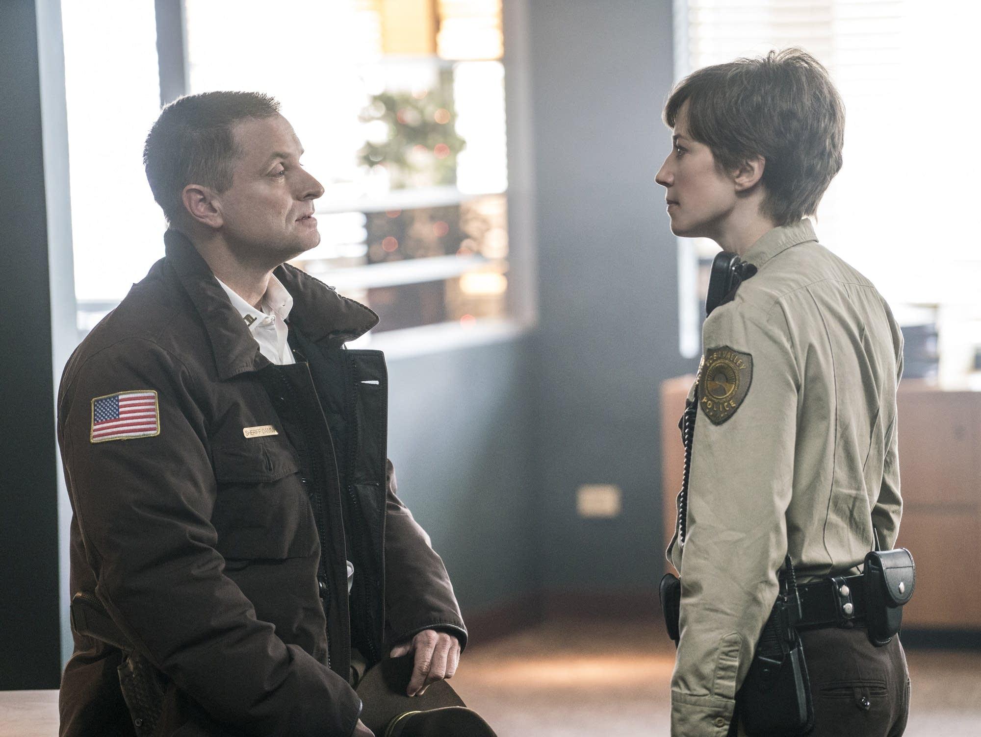 Sheriff Moe Dammik (Shea Whigham) lectures Gloria Burgle (Carrie Coon)