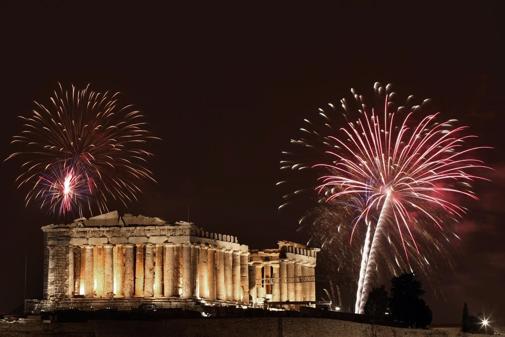 Fireworks burst over the ancient temple in Greece