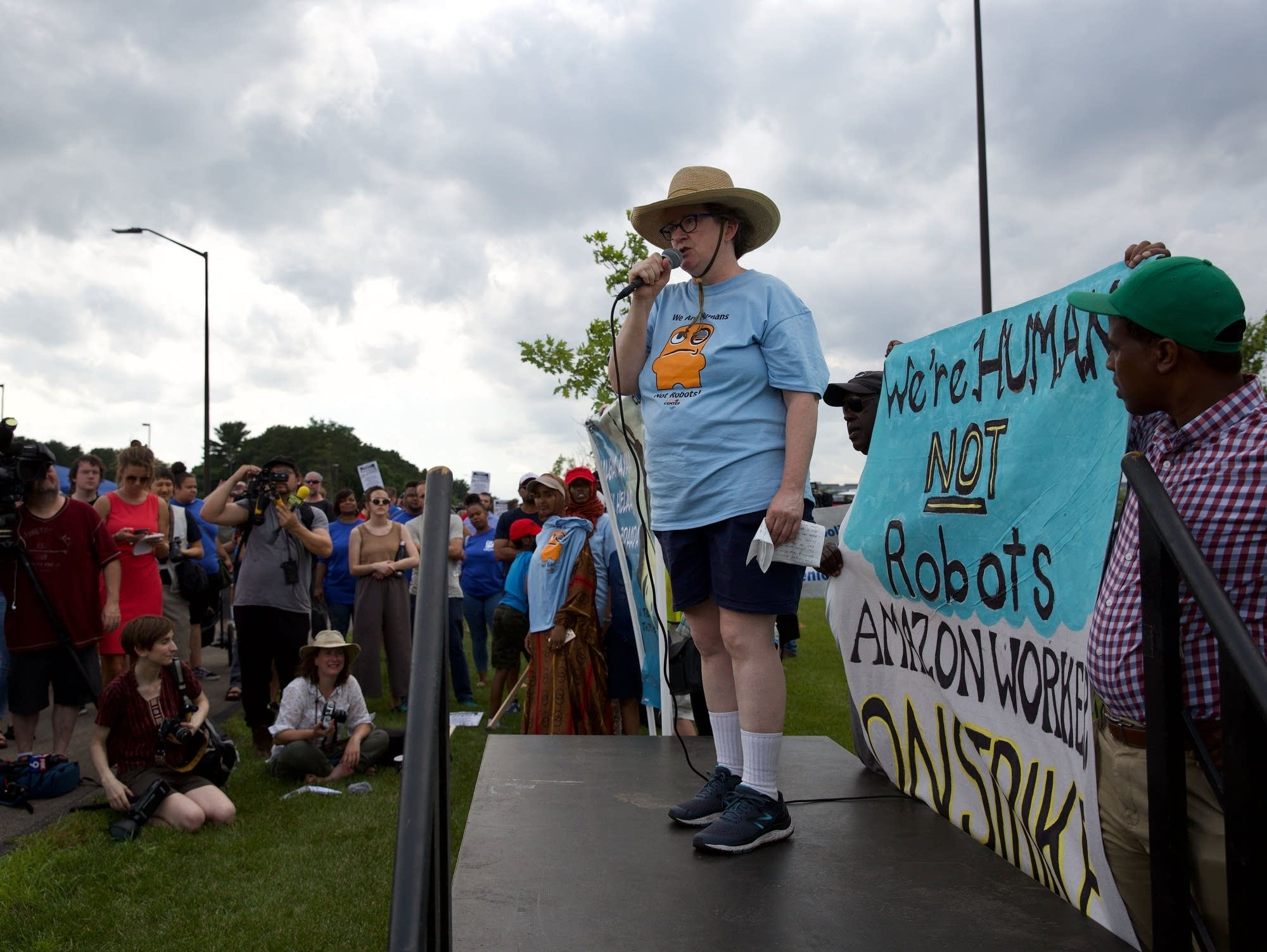 Amazon employee Meg Brady speaks at a rally outside the Amazon warehouse.