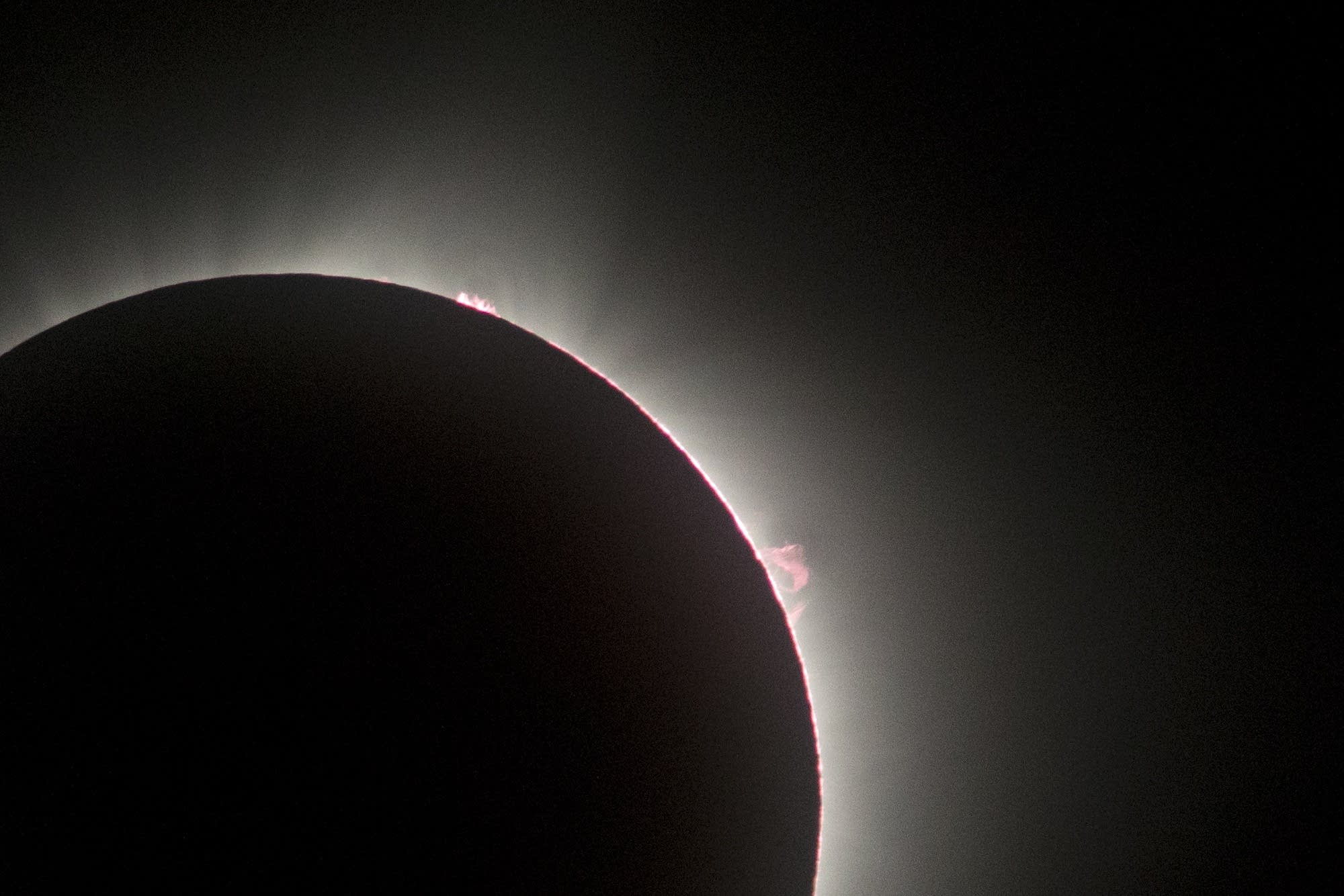 The pink layer around the moon is called the chromosphere.
