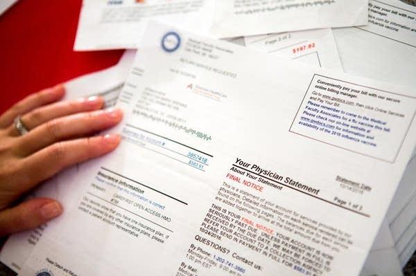 Christina Arenas reviews her medical bills at home in Washington, D.C.