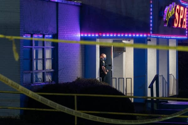 A police officer stands outside a crime scene.