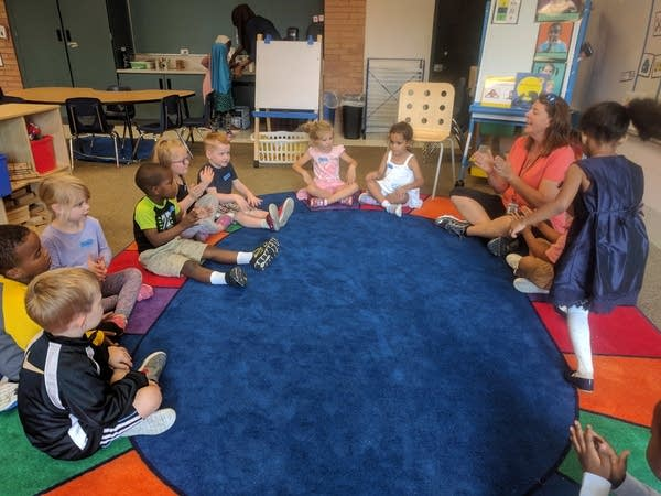 Teacher Sharon Smith Lossiah leads preschool students in circle time.