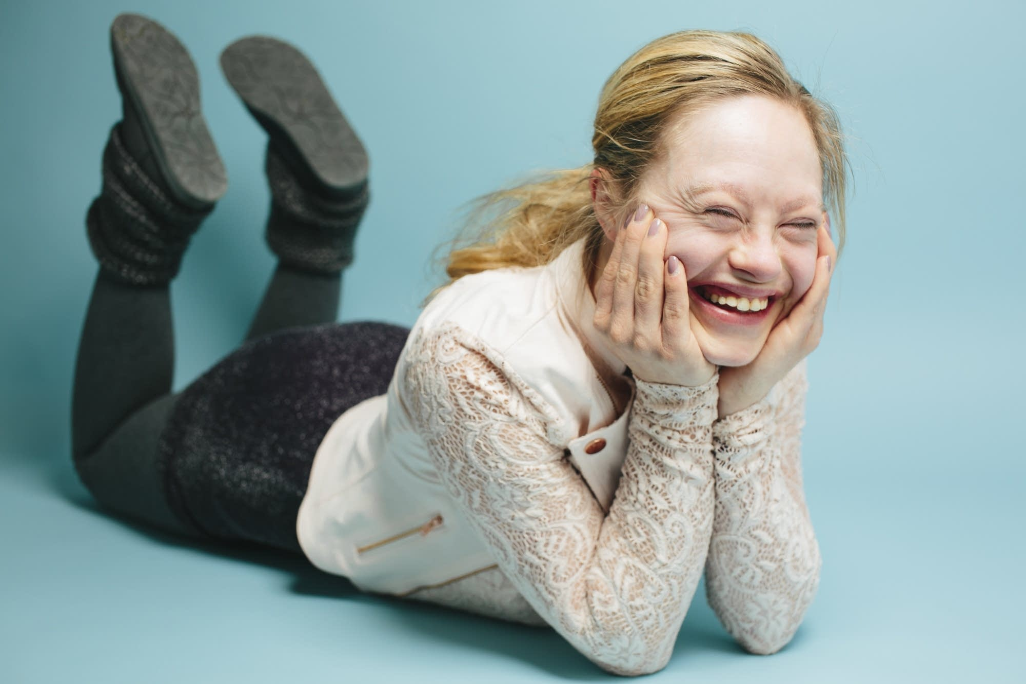 Mikayla Holmgren laughs during a portrait session