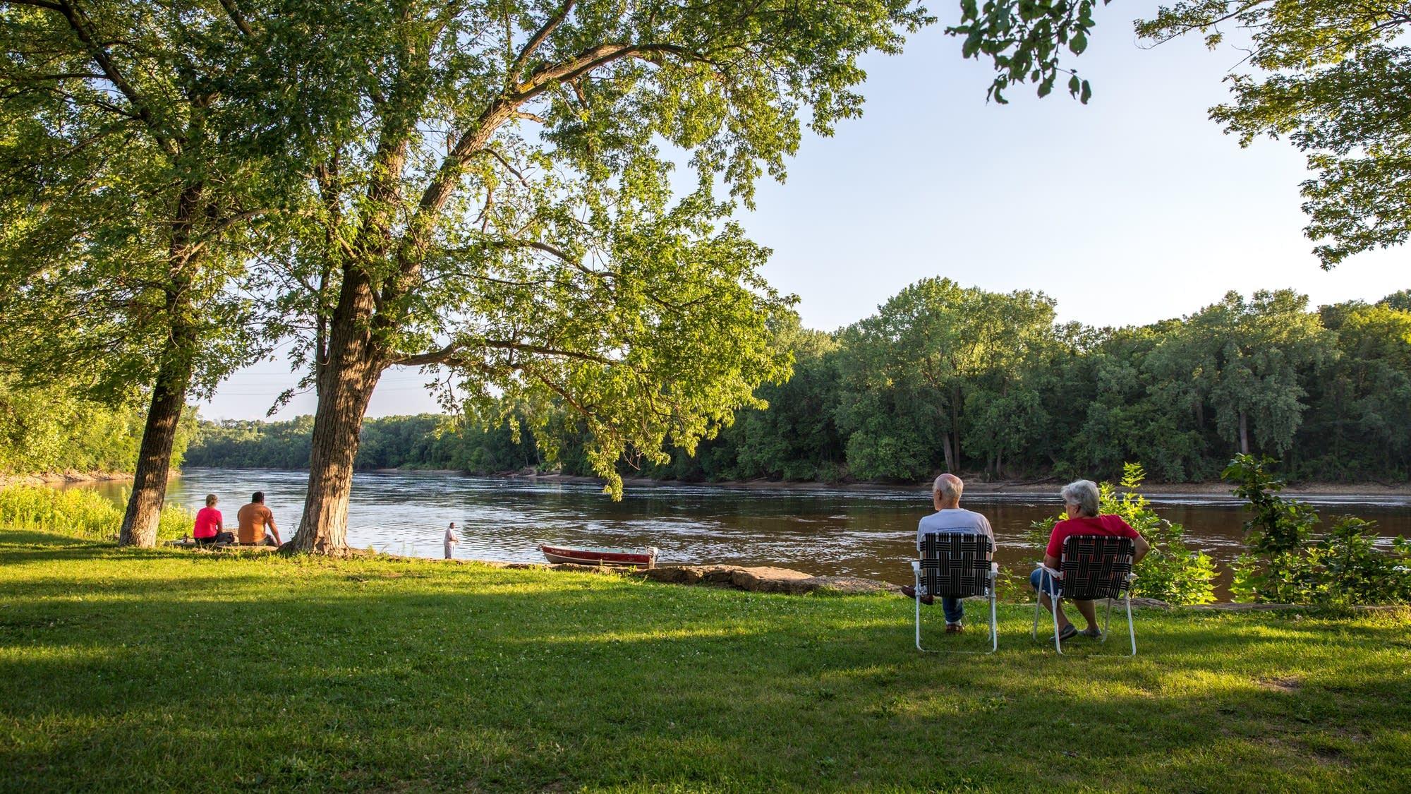 A couple enjoys Hidden Falls Regional Park