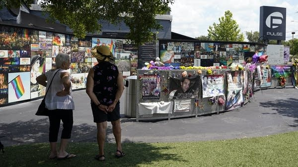 People visit a memorial site