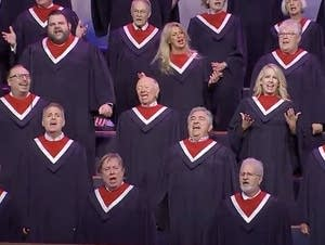A 100-voice choir sings at a rally Sunday in Texas.