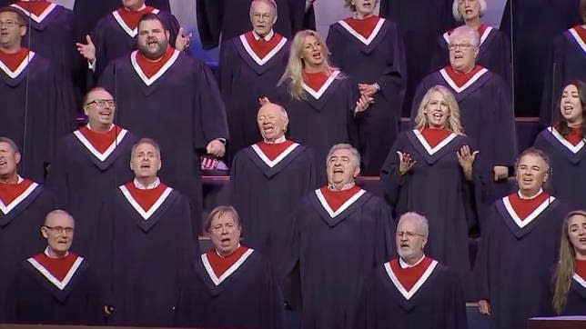 A 100-voice choir sings at a rally Sunday in Texas.