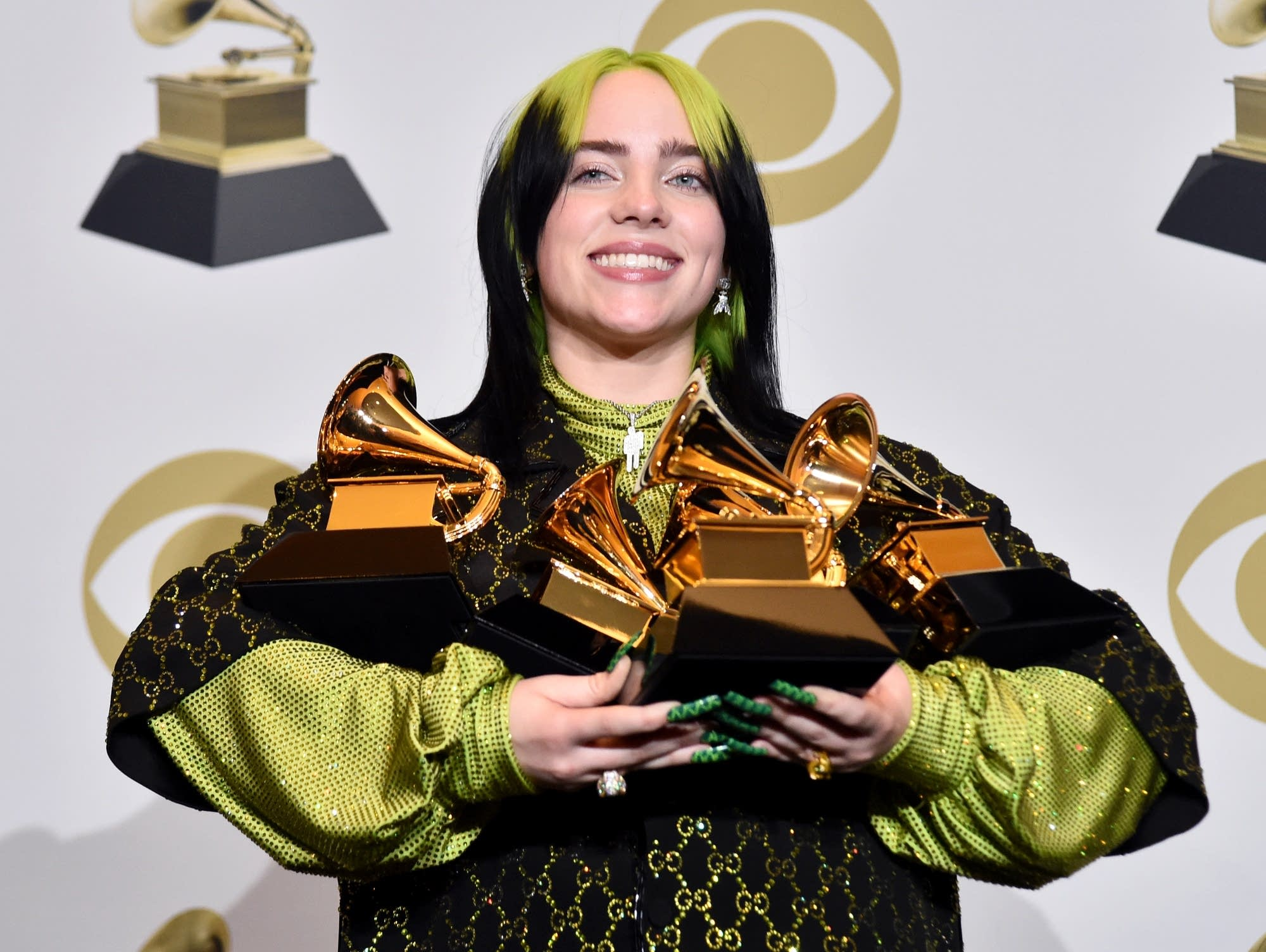 Billie Eilish with some of her awards at the 62nd Annual GRAMMYs.