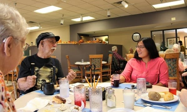 Ashley McGaw has lunch with John Bernadot at Senior Living at Watkins.