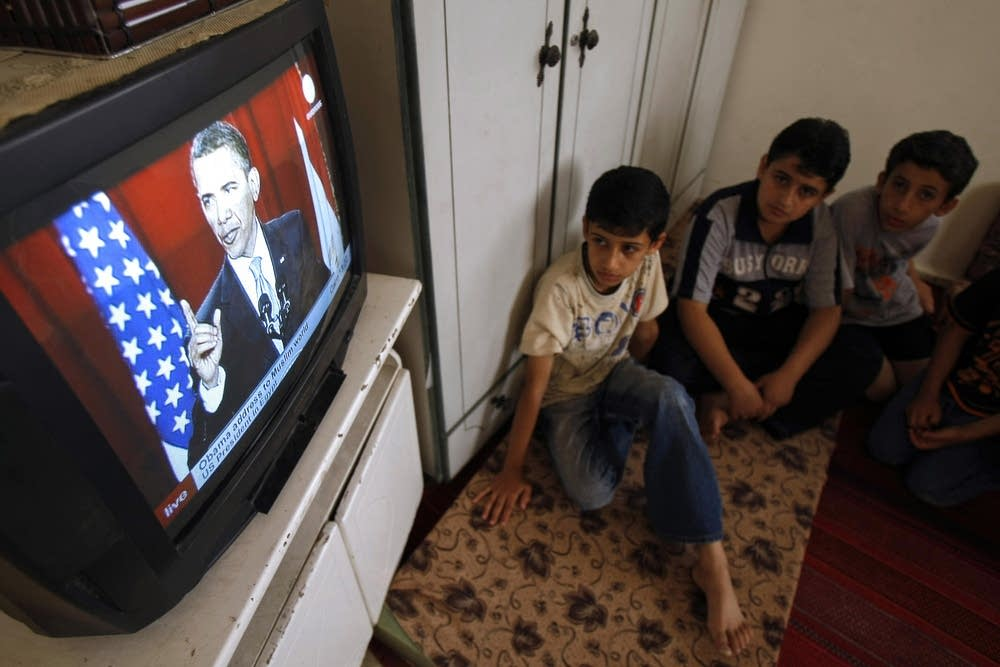 Palestinian boys listen to Obama