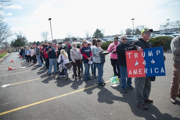 Trump supporters wait in line.