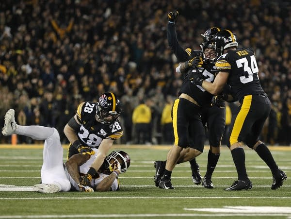 Iowa defensive back Riley Moss (center) celebrates