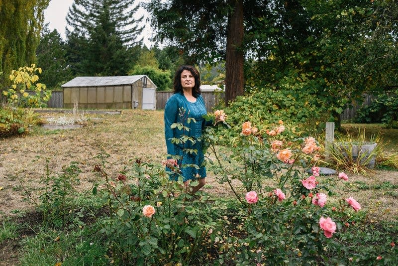 Janet Winston stands in her rose garden in Eureka, Calif.
