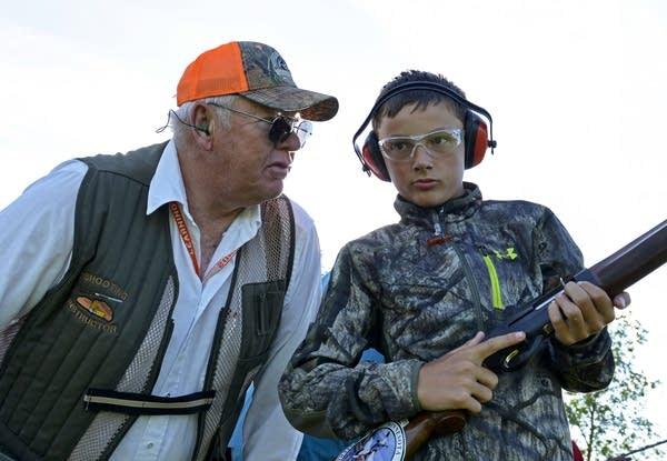 Instructor Steve Pagel (left) coaches Joey Heiser on the shooting range.