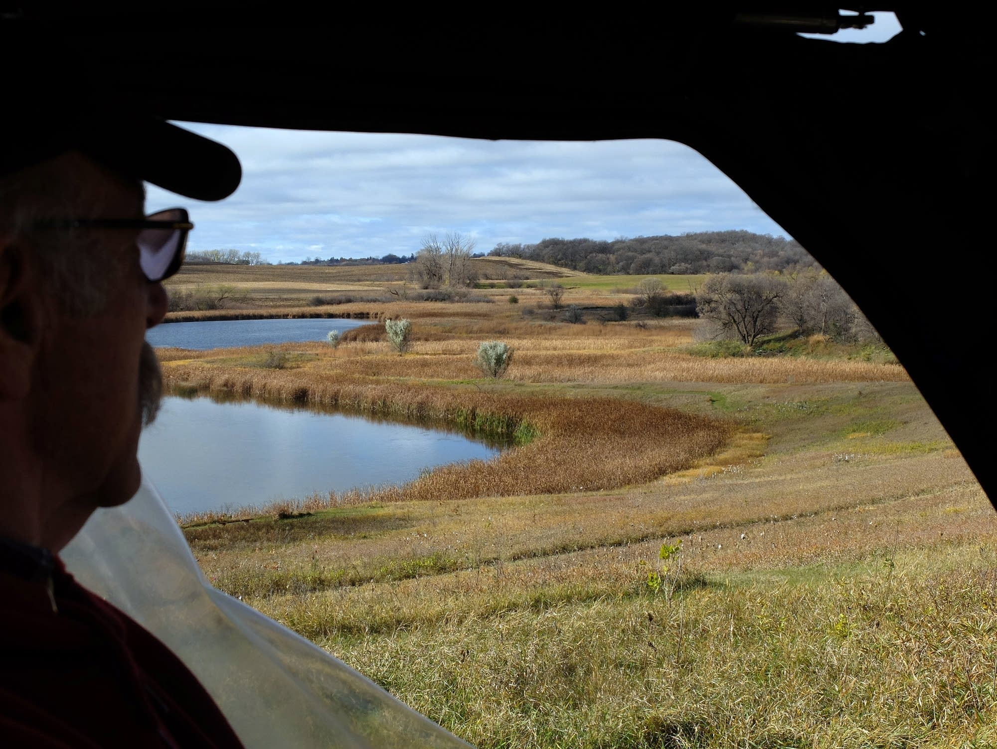 Stan Overgaard looks over restored prairie on his farm.