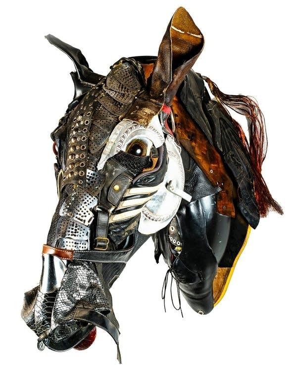 A sculpture of an animals head made of metal.