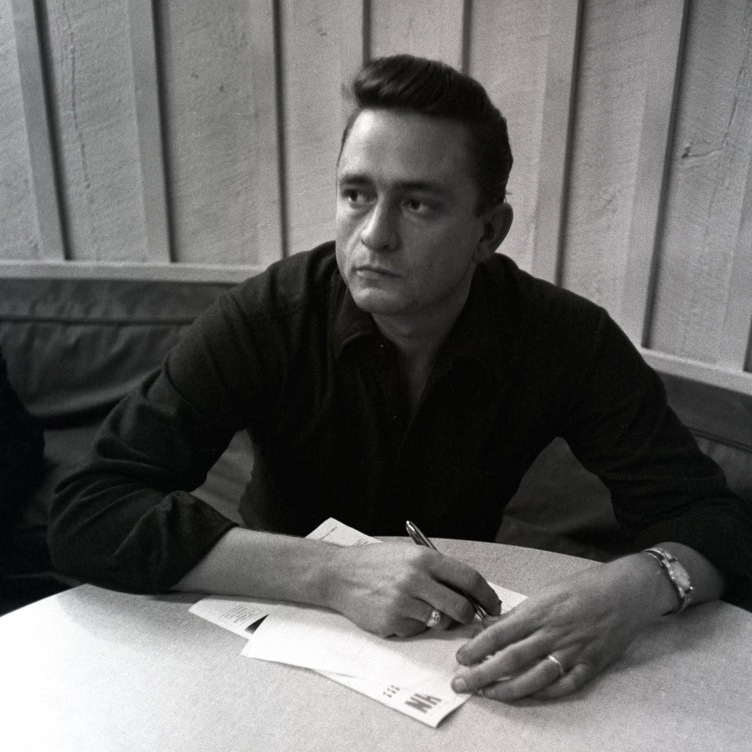 Johnny Cash writing; photo by Don Hunstein