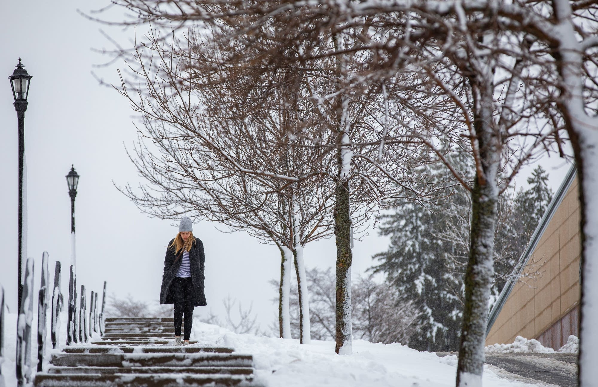 Hanna Dahlberg walks on snow-covered steps at College of St. Scholastica.