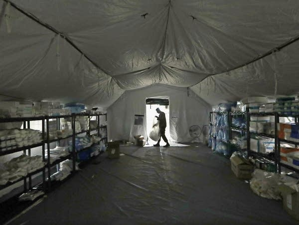 A U.S. Army soldier walks inside a mobile surgical unit