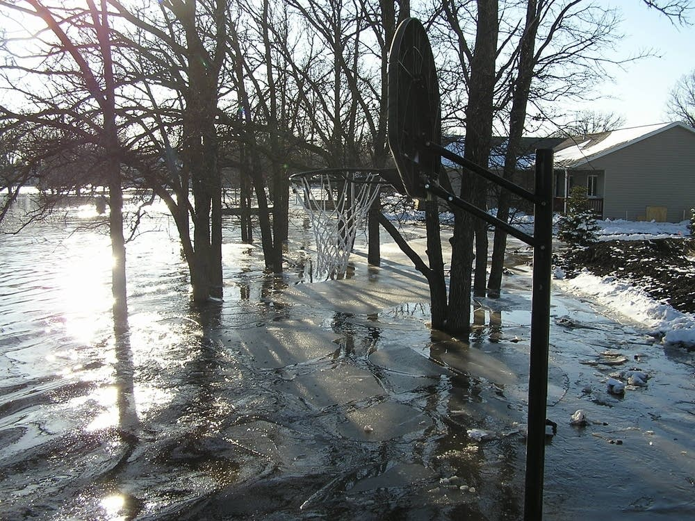 An Oakport house sits several feet underwater