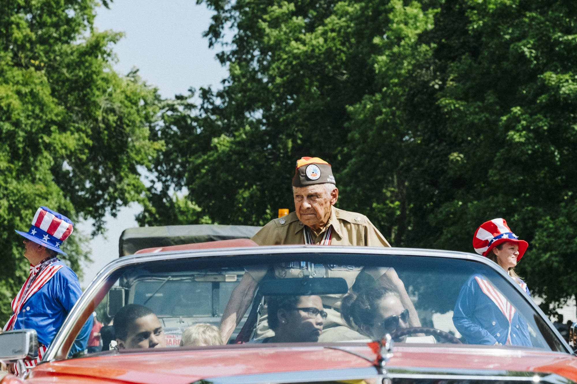 World War II veteran Fred Gordon rides in the parade.
