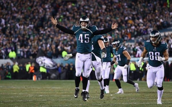 Rick Lovato (45) celebrates the third quarter touchdown reception.