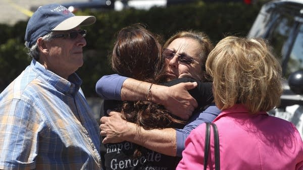 Members of the Chabad synagogue hug in Poway, Calif.