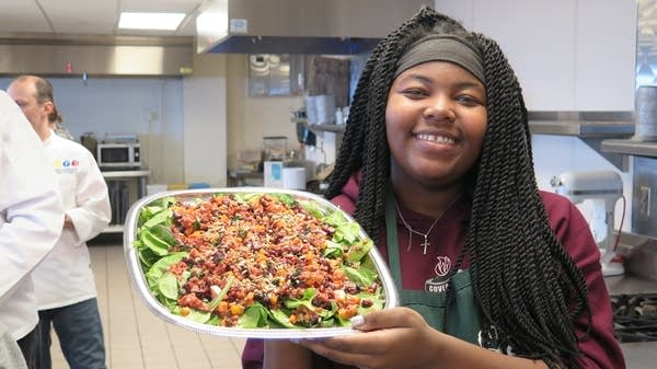 "Princess Ann Nelson shows off her ""Roots for the Home Team"" salad."