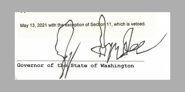 Gov. Jay Inslee's scrawled, left-handed signature on a piece of legislation