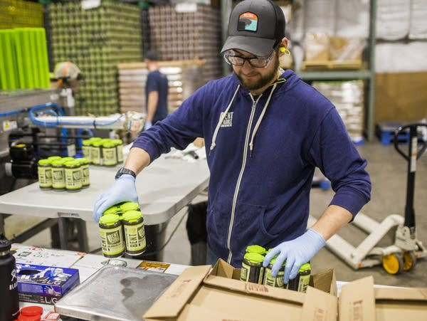 Dylan Klein packs Bent Paddle beers into crates