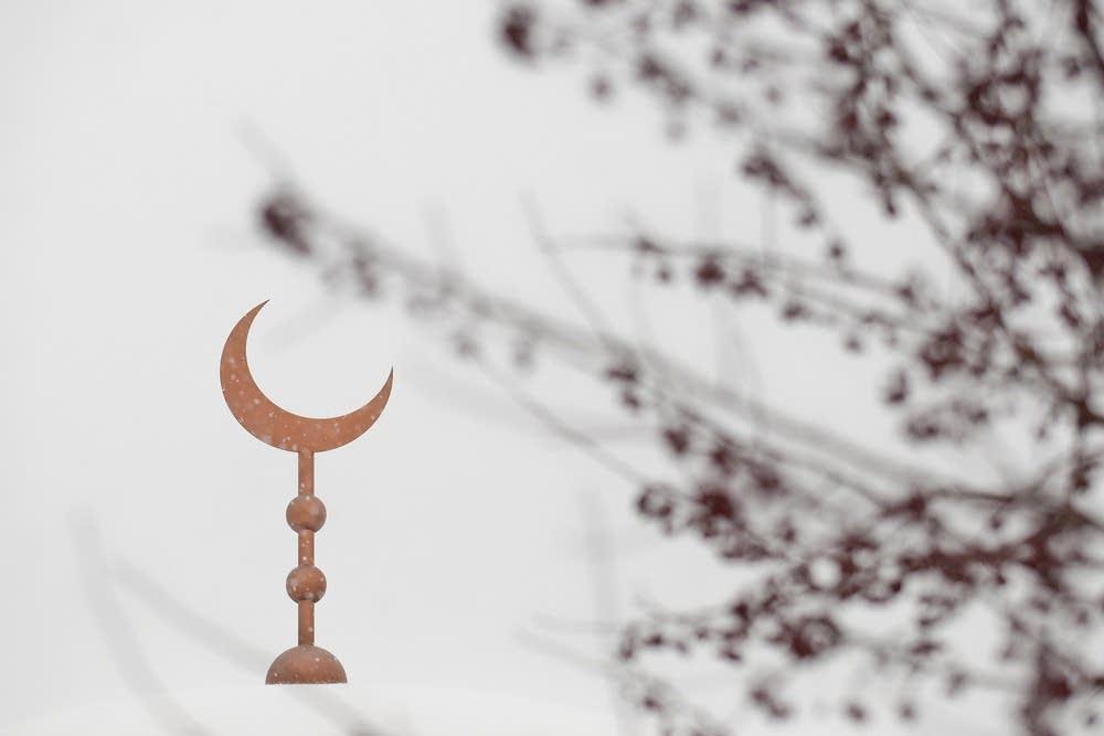 A light snow falls on the Masjid An-Nur mosque.