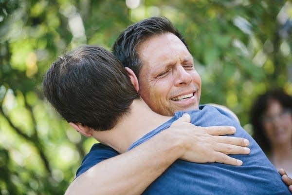 Don Damond hugs a supporter.
