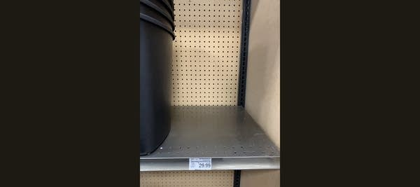 Empty store shelf where garbage cans used to be (sold out)