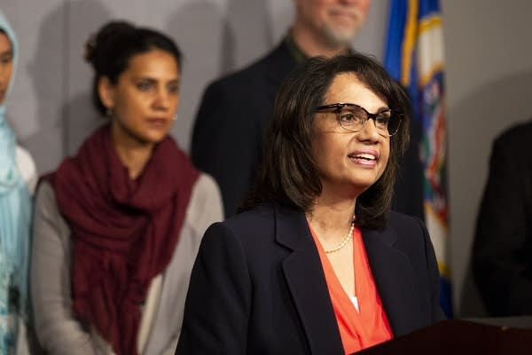 Zarina Baber answers questions at a press conference.