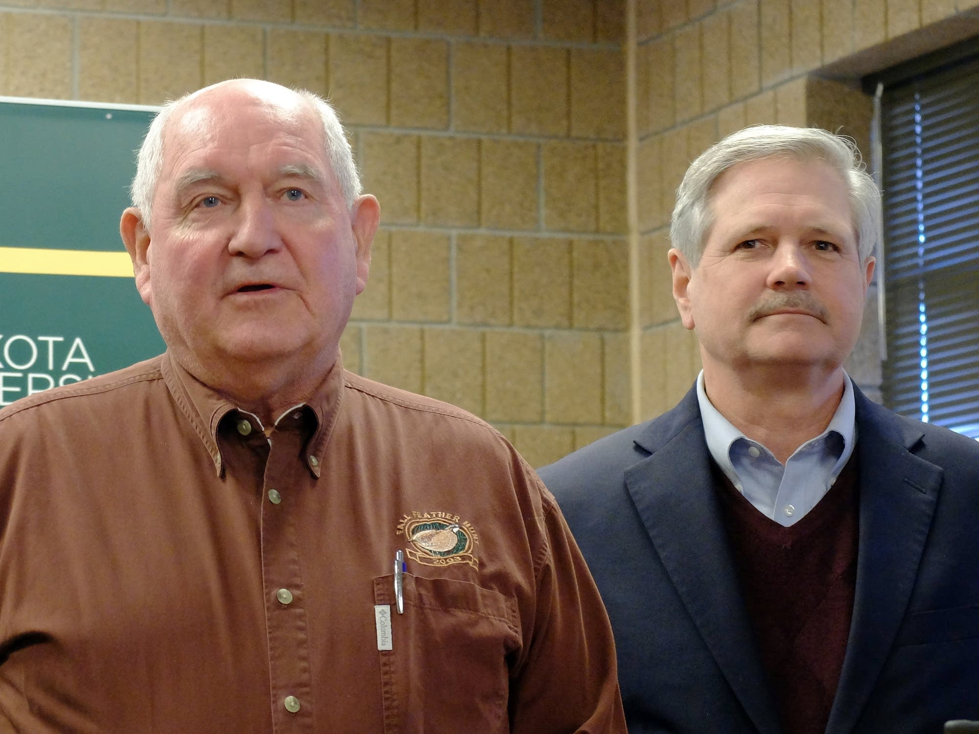 U.S. Agriculture Secretary Sonny Perdue, left, speaks with reporters.