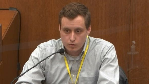 A man testifies in court.