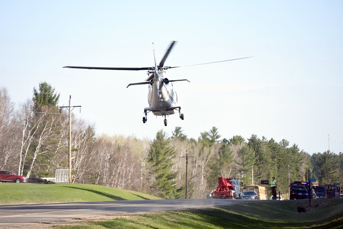 A North Memorial helicopter leaves the scene of a school bus accident.